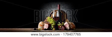 Composition with wine and food on a black background