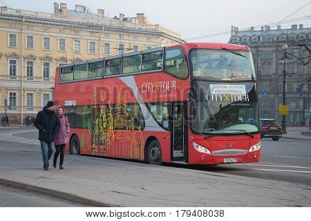 SAINT PETERSBURG, RUSSIA - MARCH 12, 2017: Tour double-decker bus Volvo on a city street on a cloudy day