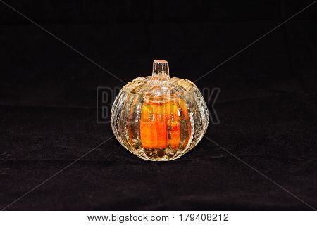 pumpkin shaped candle holder (three and a half inches tall, three and a half wide)