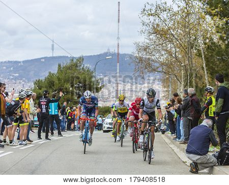 Barcelona Spain - March27 2016: Group of cyclists riding on the road to the top of Montjuic in Bracelona Spain during Volta Ciclista a Catalunya on March 27 2016.