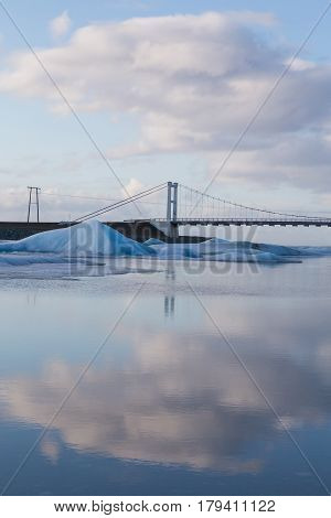 Brige corssing Jakulsalon lagoon with reflection sky background Iceland winter natural lanscape background