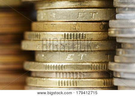 Various coins stacked are shown up close