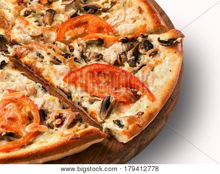 Close up view on piece of pizza with mushrooms on wooden cutting board. Isolated on white with clipping path
