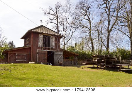 Stable and dovecote gathered on a small coast in a wildlife park in France