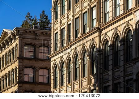 Typical Soho building facades with ornamentation and terraces Manhattan New York City
