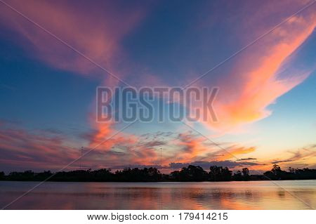 Amazing Pink And Blue Sunset Sky Reflected In River Water