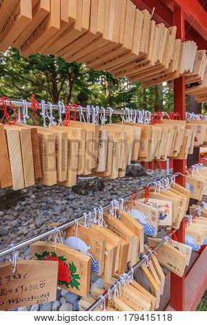 NIKKO JAPAN - APRIL 16 2014: Ema plaques at a Toshogu Shrine in Nikko Japan on April 16 2014. Shrine visitors write their wishes on wood plates and leave them inside the Toshogu shrine in the hope that their wishes come true.