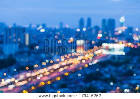 Twilight blurred bokeh aerial view city and highway road night view abstract background
