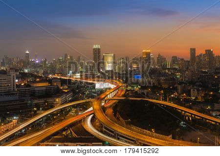 Beautiful sunset sky background over city highway overpass interchanged and business downtown background