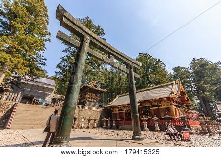 NIKKO JAPAN - APRIL 15 2014: People visit Tosho-gu Shrine on April 15 2014 in Nikko Japan. Toshogu is part of a UNESCO World Heritage Site group of very important temples in Japan.