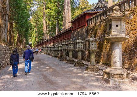 Stone pillar lanterns pathway on the Side of Toshogu Shrine that lead to Futarasan Shrine in Nikko Tochigi Japan