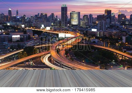 Opeing wooden floor Twilight city office downtown and highway intersection Bangkok Thailand