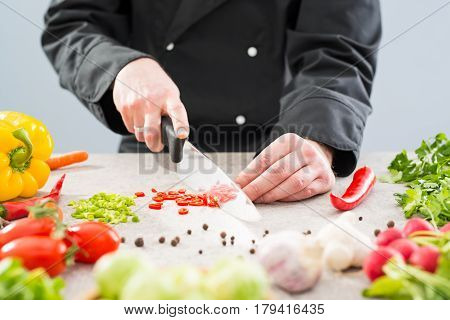cooking chef chop cut food prepare vegetables women salad cutting chopping mediterranean home kitchen people hand board concept