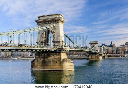 Budapest, Hungary - January 3, 2017: the Chain bridge in the historical part of Budapest, on the background of blue sky