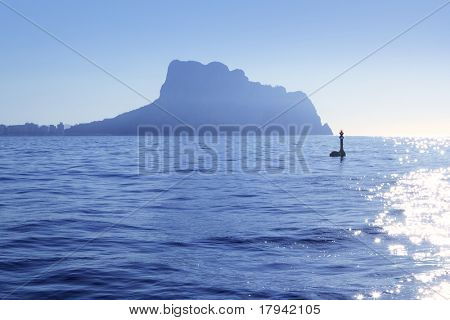Ifach Penon mountain from Calpe fog backlight floating beacon