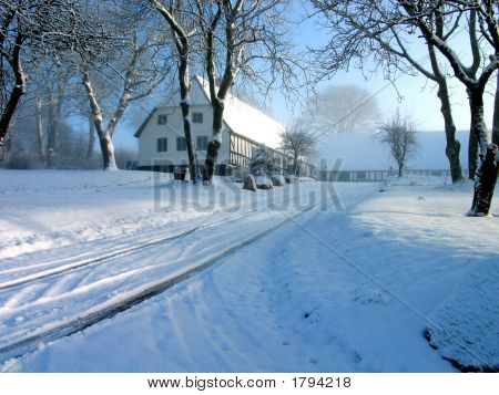 Farmhouse In Snow