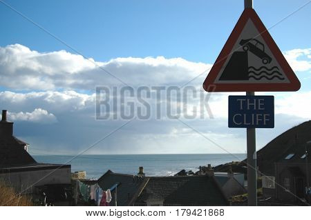 The Cliff - Funny Sign in Collieston, Aberdeenshire