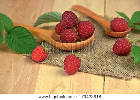 Ripe raspberries in a wooden spoon. Healthy eating. Red raspberries . raspberries fruits. (selective focus)