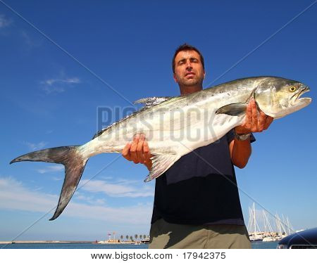 Fisherman holding catch Garrick Lichia Amia Leerfish Leervis fishJack
