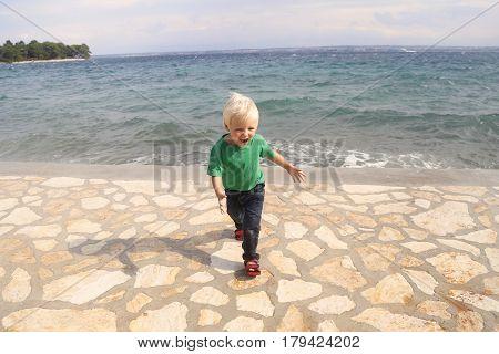 Boy By The Adriatic Sea