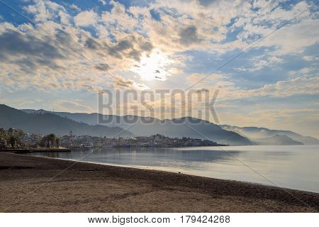 Marmaris city center in misty weather with sun among clouds