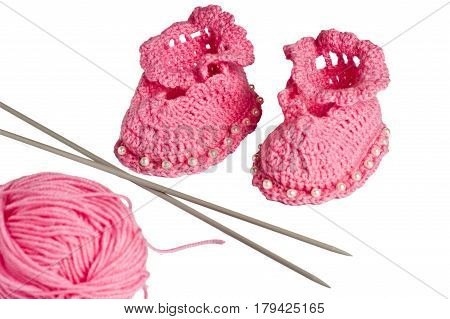 knitted, pink booties for children on a white background