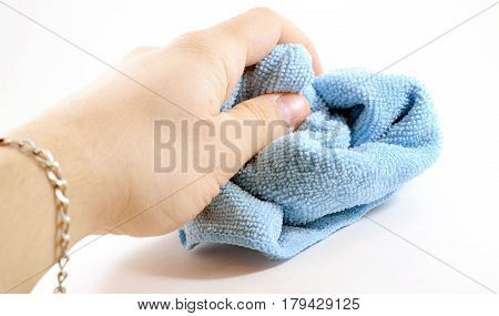 Male Hand Holding Blue Microfiber Cleaning Cloth
