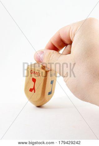 Male Hand Spinning Wooden Dreidel