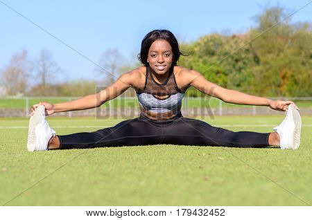 Friendly Fit Young Woman Doing The Splits