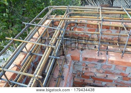 Corner. Rebar steel bars reinforcement concrete bars with wire rod. Brickwork with Iron Bars for House Construction Building Corner Brick House Wall.