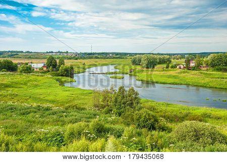 Rural summer landscape with a river bank
