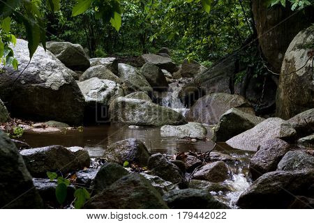 Abstract stone with waterfall in Chonburi Thailand. waterfall after rain. waterfall in the forest.