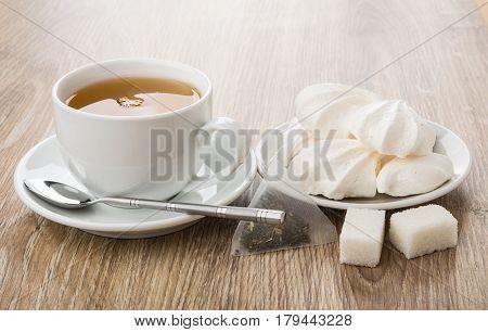 Tea In Cup, Meringue In Saucer, Tea Bag, Lumpy Sugar