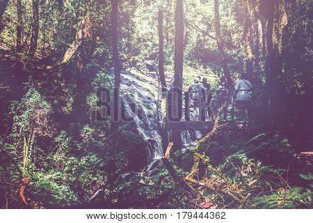 Hiking trails Natural forest waterfall. Tourists tour. Standing on the terrace to admire the beauty of natural waterfalls.fresh air sunlight shines through. Thailand chiangmai doiinthanon kew-mae-pan