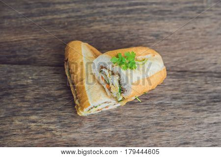 A Delicious Vietnamese Bahn Mi Sandwich On A Wooden Background