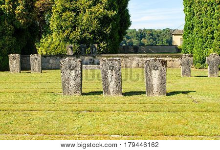 Burghausen,Germany-August 23,2015: Stones lie on the headstones of the graves of jewish victims of an outpost of the Dachau Concentration Camp at a memorial cemetery in BurghausenGermany