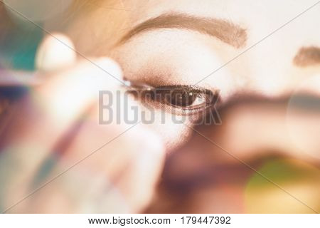background Beautiful model applying eyeliner closeup on eye