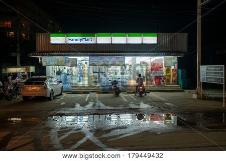 HUA HIN, THAILAND - JANUARY 17, 2017: Street scene at night in Hua Hin after rain during daytime. The wet season in Thailand was delayed in 2016 with heavy rains continuing into January 2017.
