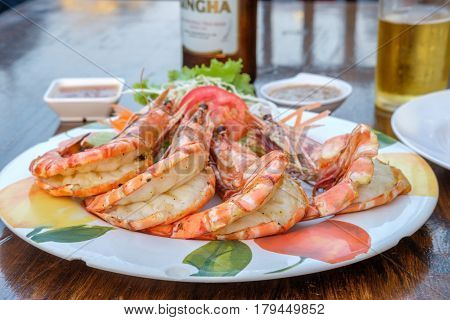 HUA HIN, THAILAND - FEBRUARY 16, 2017: Tiger prawn barbeque served at the night market. The famous night market is a popular tourist attraction in Hua Hin.