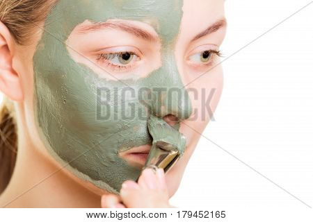 Woman Applying With Brush Clay Mud Mask Her Face