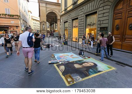 Florence ITALY- September 11 2016: Street painters have painted famous pictures of masterpiece on the road of street and in this way they are earning money