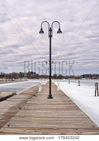 Public dock in Clayton New York with spring thaw