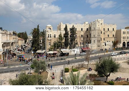 JERUSALEM ISRAEL - MARCH 25 2017: View from the Shekhem Gate to the French Dominican Monastery of St. Etienne and the Church of St. Stephen