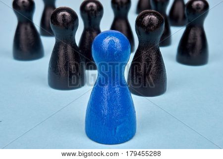 Symbol for leadership with game figures - macro shot