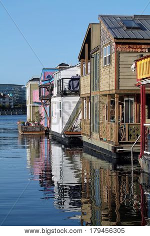 Houseboats Reflected in the Waters of the Bay