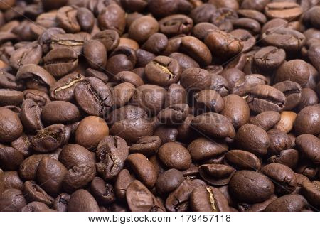 brown roasted coffee beans in bulk close-up