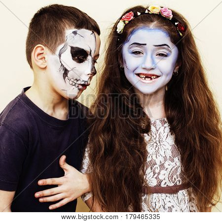 zombie apocalypse kids concept. Birthday party celebration facepaint on children dead bride, scar face, skeleton together, halloween holiday close up