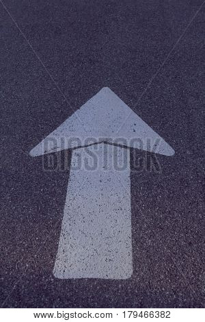 Large white arrow painted on the road