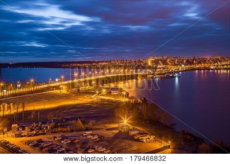 Evening Voronezh cityscape from rooftop. View of the bridge over the Voronezh Water Reservoir poster