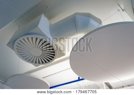 The system of air conditioning and ventilation facilities. White pipes and Air outlet on the ceiling for air conditioning work room or office.
